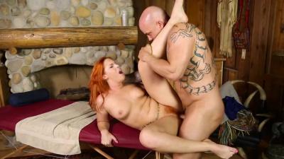 Lucky client receives a deep tissue massage from red headed masseuse Edyn Blair