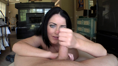 Big titty Sophie Dee kerks off cock with two hands