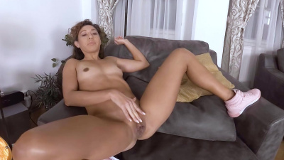 Melody Petite performing passionate striptease and playing solo sex games at home